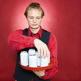 Rearranging cans Stock Image