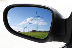 Rearview car driving mirror electric windmills Stock Images
