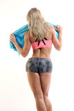 Rearview of a cute young fitness woman with a towel Stock Photos
