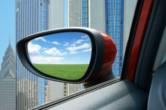 Rearview Mirror. From the car rearview mirror to see the grassland landscape Stock Photography