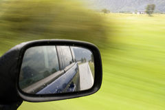 Rearview mirror. Side mirror of a car in motion Royalty Free Stock Photos