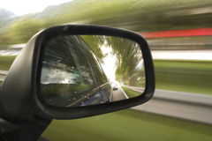 Rearview mirror. Side mirror of a car in motion Stock Photo