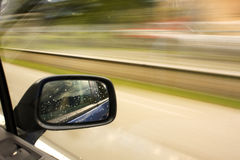 Rearview mirror. Side mirror of a car in motion Royalty Free Stock Images