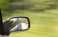 Rearview mirror. Side mirror of a car in motion Royalty Free Stock Photography