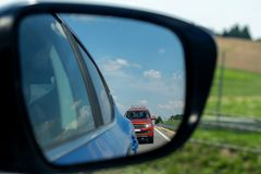 The rearview mirror of the car shows another car at the rear. The rearview mirror of the car shows another car at the rear royalty free stock images