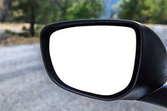 Rearview Mirror. Close up front view of rearview mirror of a car with blank copy space, on road scene background Royalty Free Stock Image