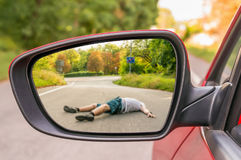Rearview mirror with a man hit by a car Stock Image
