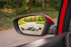 Rearview mirror with a man hit by a car Stock Images