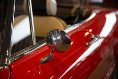 Rearview mirror of a red car Royalty Free Stock Photo