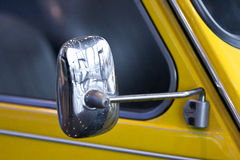 Rearview of an old sport car. Rearview of an old yellow sport car Royalty Free Stock Photos