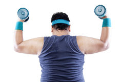 Rearview overweight man doing fitness Stock Photos