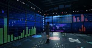 Rearview van onderneemster die digitale animatie van gloeiende grafiekinterface bekijken