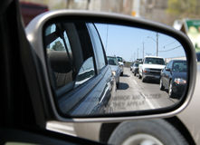 Rearviewmirror Traffic. A traffic jam from the view of rearview mirror Stock Photos