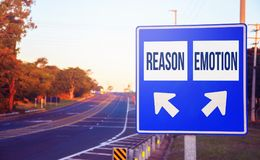 Reason or Emotion choices, decision, option. Road sign on a highway with two different choices and arrows indicating the destination or decision Royalty Free Stock Photography