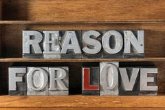 Reason for love. Phrase made from metallic letterpress type on wooden tray stock photography