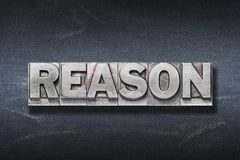 Reason word den. Reason word made from metallic letterpress on dark jeans background royalty free stock image