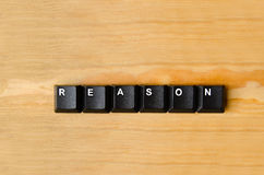 Reason word. With keyboard buttons royalty free stock photography