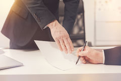 Reasonable decisive businessman signing the document Royalty Free Stock Photos