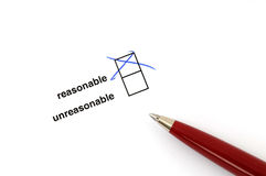 Reasonable or not. Checkbox for selection on white paper with ballpen Royalty Free Stock Photography