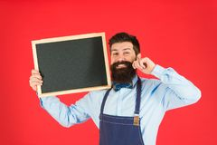 Reasonable prices. menu board. bearded hipster cook in apron. great cuisine. cooking by recipe. welcome. Restaurant or. Cafe advertising. happy man chef with royalty free stock image