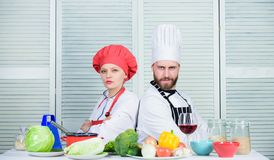 Reasons why couples cooking together. Cooking with your spouse can strengthen relationships. Woman and bearded man. Reasons why couples cooking together. Cooking stock images
