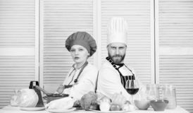 Reasons why couples cooking together. Cooking with your spouse can strengthen relationships. Woman and bearded man. Culinary partners. Ultimate cooking royalty free stock image