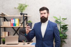 Reasons why you should drink coffee at work. Man bearded manager businessman hold cup of coffee. Relaxed top manager stock image