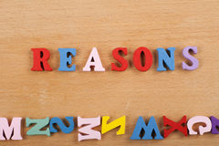 REASONS word on wooden background composed from colorful abc alphabet block wooden letters, copy space for ad text Stock Image