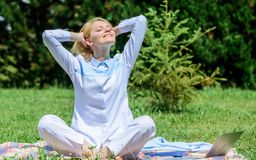 Reasons you should meditate every day. Clear your mind. Girl meditate on rug green grass meadow nature background. Find. Minute to relax. Woman relaxing royalty free stock photo