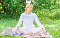 Reasons you should meditate every day. Find minute to relax. Clear your mind. Girl meditate on rug green grass meadow. Nature background. Every day meditation royalty free stock photography
