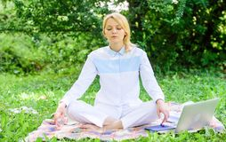 Reasons you should meditate every day. Find minute to relax. Clear your mind. Girl meditate on rug green grass meadow. Nature background. Every day meditation royalty free stock images