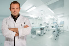 Reassuring male doctor in operating room Royalty Free Stock Image