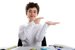 Reassuring  young boy indicates something on his hand Stock Images