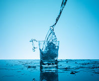 Сreative splashing water in the glass Royalty Free Stock Photo