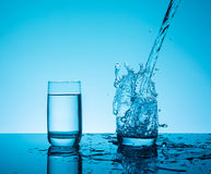 Сreative splashing water in the glass Stock Photos