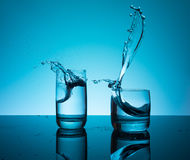 Сreative splashing water in the glass Royalty Free Stock Images