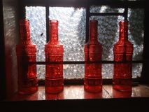 Red stain bottle stock images