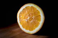 Rebanada anaranjada en la madera Imagen de archivo