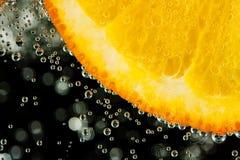Rebanada anaranjada jugosa imagenes de archivo