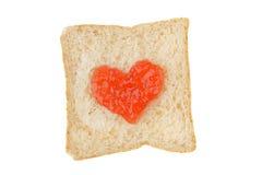 Rebanada blanca del pan del trigo integral con el atasco Foto de archivo libre de regalías