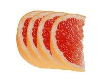 Rebanada de agrios del pomelo aislados en blanco imagenes de archivo