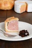 Rebanada de empanada de cerdo con la fork Imágenes de archivo libres de regalías