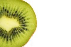 Rebanada de fruta de kiwi fresca aislada en el fondo blanco fotografía de archivo