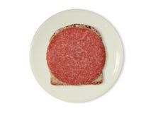 Rebanada de pan con el salami Fotos de archivo