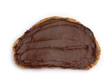 Rebanada de pan con la extensión del chocolate Imagen de archivo libre de regalías