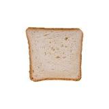 Rebanada de pan de la tostada del trigo en un fondo blanco Imagen de archivo