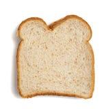 Rebanada de pan del trigo en un fondo blanco imágenes de archivo libres de regalías