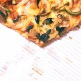 Rebanada de pizza de sobra foto de archivo