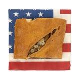 Rebanada de stromboli cocido del filete en una servilleta Fotos de archivo libres de regalías