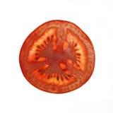 Rebanada de tomate aislada en blanco Fotografía de archivo libre de regalías